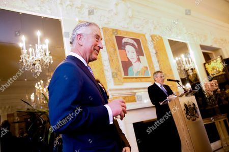 Stock Image of Prince Charles Britain's Prince Charles, left, smiles as British Ambassador to the United States Sir Peter Westmacott, right, gives welcoming remarks during a private reception at the British Ambassador's Residence on in Washington