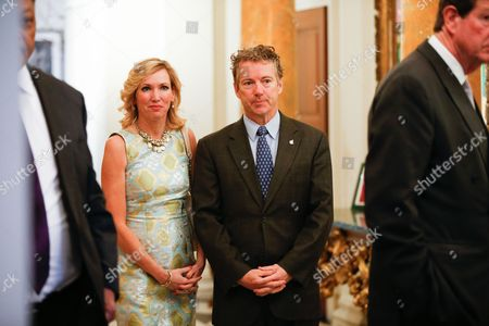 Prince Charles, Rand Paul, Kelley Ashby Sen. Rand Paul (R-Ky.), right, and his wife Kelley Ashby, left, arrive at a private reception for Britain's Prince Charles at the British Ambassador's Residence on in Washington
