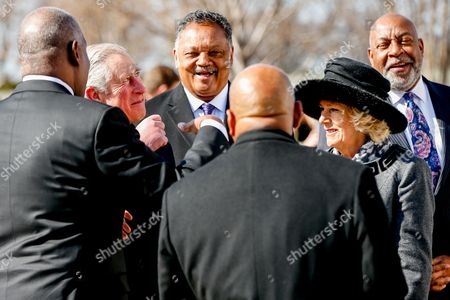 Prince Charles, Camilla the Duchess of Cornwall Britain's Prince Charles, second from left, smiles as he and his wife Camilla, the Duchess of Cornwall, second from right, talk with President and CEO of the Martin Luther King, Jr. Memorial Project Foundation Harry Johnson, left, Rev. Jesse Jackson, third from left, Rep. John Lewis, D-Ga., third from right, and President of the Tommy Hilfiger Corporate Foundation Guy Vickers, right, while touring the Martin Luther King, Jr. Memorial on in Washington. The royal couple are visiting cultural and educational sites in the Washington region