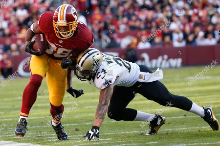 Pierre Garcon, Kyle Wilson Washington Redskins wide receiver Pierre Garcon (88) is knocked out of bounds by New Orleans Saints defensive back Kyle Wilson (24) during the second half of an NFL football game in Landover, Md