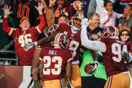 Dashon Goldson, DeAngelo Hall, Preston Smith Washington Redskins free safety Dashon Goldson (38) celebrates his touchdown with teammates cornerback DeAngelo Hall (23)m and linebacker Preston Smith (94) during the second half of an NFL football game against the New Orleans Saints in Landover, Md