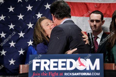 Rick Santorum, Karen Santorum Former Pennsylvania Sen. Rick Santorum gets a hug from his wife Karen after announcing he is suspending his candidacy for the presidency, in Gettysburg, Pa