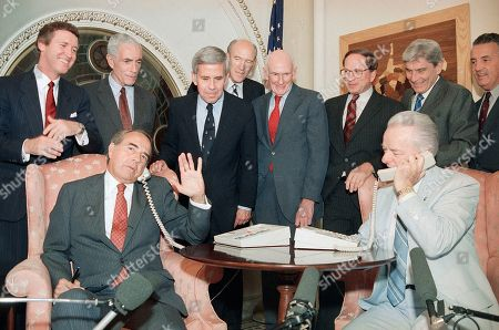 Senate Minority leader Sen. Robert Dole of Kansas, left, and Senate Majority leader Sen. Robert Byrd of West Virginia call President Reagan in Helsinki from Capitol Hill, Washington, to inform him of the ratification of the INF treaty. Behind them are, from left, Sen. William Cohen, R-Maine; Sen. Claiborne Pell, D-R.I.; Sen. Richard Lugar, R-Ind.; Sen. Alan Simpson, R-Wyo.; Sen. Alan Cranston, D-Calif.; Sen. Sam Nunn, D-Ga.; Sen. John Warner, R-Va., and Sen. Paul Sarbanes, D-Md