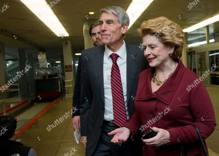 """Stock Photo of Debbie Stabenow, Mark Udall Senators Debbie Stabenow, D-Mich., right, and Mark Udall, D-Colo., walk from the Senate subway on Capitol in Washington, . President Barack Obama on Friday urged the Senate to ratify a $1.1 trillion spending bill that has roiled his Democratic Party, judging it an imperfect measure that stems from """"the divided government that the American people voted for"""