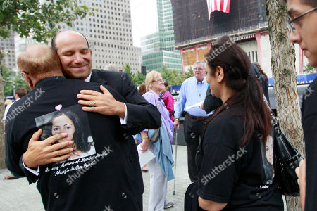 Howard Lutnick Cantor Fitzgerald CEO Howard Lutnick, second right, hugs a family member of a Cantor Fitzgerald employee at the National September 11 Memorial during a ceremony marking the 10th anniversary of the attacks at the World Trade Center, in New York