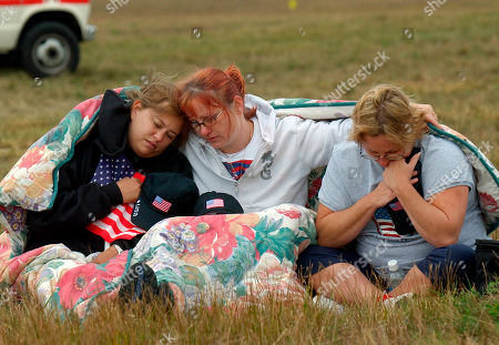 BARRY STARR WAGNER From left, Shannon Barry, Lisa Starr and Michelle Wagner, all of Hershey, Pa., react as they listen to a memorial service for victims of Flight 93 near Shanksville, Pa., . President Bush will lay a wreath at the crash site later in the day to mark the anniversary of the terrorist attacks