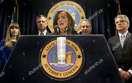 "Annie Palazzolo, far left, her father Paul Boke, second from left, New York Attorney Gen. Eric Schneiderman, second from right and San Francisco District Attorney George Gascon, far right, listen as Nassau County, N.Y. District Attorney Kathleen Rice speaks during a press conference, in New York. The group announced the launch of what they call the ""Secure Our Smartphones Initiative"" aimed at encouraging the cell phone industry to adapt technology to deter cell phone theft. Palazzolo, 29, spoke about her sister who was killed for her cellphone"