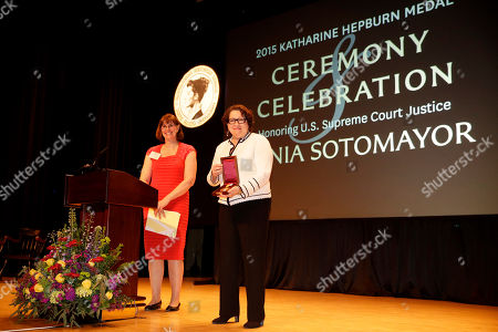 """Sonia Sotomayor, Kim Cassidy Supreme Court Justice Sonia Sotomayor, right, displays her 2015 Katharine Hepburn Medal from Bryn Mawr College as college president Kim Cassidy looks on during a ceremony, in Bryn Mawr, Pa. The women's liberal arts school near Philadelphia honored Sotomayor with the medal, given to women who embody """"the intelligence, drive and independence"""" of the Oscar-winning actress. Hepburn was a 1928 graduate of Bryn Mawr"""