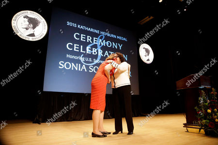 """Stock Image of Sonia Sotomayor, Kim Cassidy Supreme Court Justice Sonia Sotomayor, right, embraces Bryn Mawr College president Kim Cassidy after Sotomayor spoke at a ceremony where she received the college's 2015 Katharine Hepburn Medal, in Bryn Mawr, Pa. The women's liberal arts school near Philadelphia honored Sotomayor with the medal, given to women who embody """"the intelligence, drive and independence"""" of the Oscar-winning actress. Hepburn was a 1928 graduate of Bryn Mawr"""