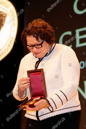 """Sonia Sotomayor Supreme Court Justice Sonia Sotomayor looks down at the Bryn Mawr College's 2015 Katharine Hepburn Medal she was awarded during a ceremony, in Bryn Mawr, Pa. The women's liberal arts school near Philadelphia honored Sotomayor with the medal, given to women who embody """"the intelligence, drive and independence"""" of the Oscar-winning actress. Hepburn was a 1928 graduate of Bryn Mawr"""