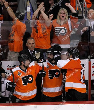 Darroll Powe, Ian Laperriere, Blair Betts Philadelphia Flyers players Darroll Powe, left, Ian Laperriere, center, and Blair Betts, right, celebrate along with fans after Jeff Carter scored an empty-net goal to ice a 5-3 win over the Chicago Blackhawks in the third period of Game 4 of the NHL Stanley Cup hockey finals, in Philadelphia. The Flyers evened the series 2-2