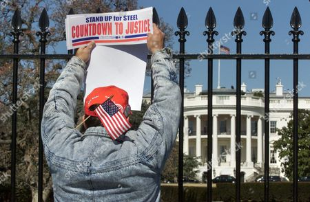 BROWN Bill Brown of Pine Grove, W.Va. holds up a sign outside the White House during a steelworkers rally. In a last ditch effort to get help from the Bush administration for their troubled industry, thousands of steelworkers held a rally near the White House on Thursday