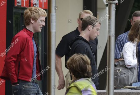 Stock Photo of Patrick Collison, Mark Zuckerberg Scientist and entrepreneur Patrick Collison, left, follows Mark Zuckerberg, chairman and chief executive of Facebook, as they head out to lunch during the at the Allen & Company Sun Valley Conference in Sun Valley, Idaho