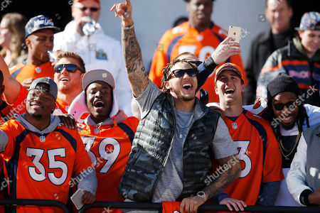 Stock Photo of Kapri Bibbs, Taurean Nixon, Shane Ray, Trevor Siemian, David Bruton From left, Denver Broncos practice squad running back Kapri Bibbs, defensive back Taurean Nixon, linebacker Shane Ray, backup quarterback Trevor Siemian and strong safety David Bruton celebrate at a rally following a parade through downtown in Denver. Fans crowded into Denver's downtown to salute the Broncos for the team's victory over the Carolina Panthers in Super Bowl 50