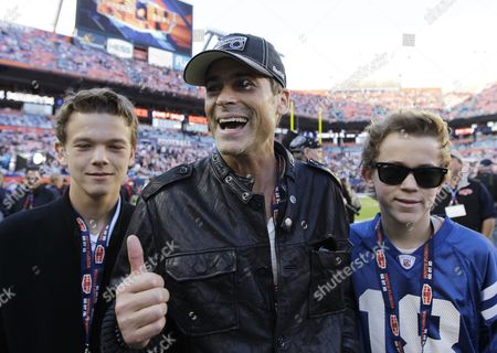 Actor Rob Lowe, center, and sons Edward Matthew, left, and John Owen walk on the sidelines before the NFL Super Bowl XLIV football game between the Indianapolis Colts and New Orleans Saints in Miami