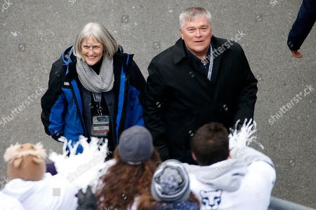 Molly Barron, Eric J. Barron Penn State President Eric J. Barron, right, and his wife Molly, look up at the student section as they leave the field before an NCAA college football game between the Penn State and the Temple in State College, Pa., . Penn State won 30-13
