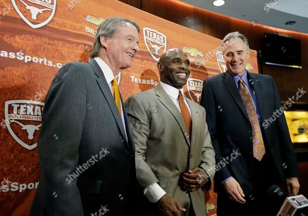 Charlie Strong, Bill Powers, Steve Patterson Charlie Strong, center, poses with Texas president Bill Powers, left, and athletic director Steve Patterson, right, following an NCAA college football news conference where he was introduced as the new Texas football coach, in Austin, Texas. Strong takes over for Mack Brown, who stepped down last month after 16 seasons