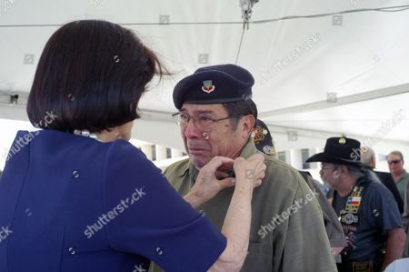 Vietnam veteran Ignacio Perez becomes emotional as Luci Baines Johnson, daughter of president Lyndon B. Johnson, pins a medal on his shirt at the Vietnam War Summit at the LBJ Presidential Library in Austin, Texas on