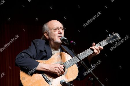 Singer-songwriter Peter Yarrow, from the 1960s folk music trio Peter, Paul and Mary, performs at the Vietnam War Summit at the LBJ Presidential Library in Austin, Texas