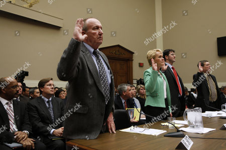 Rhonda Smith, Eddie Smith, James Lentz, David Gilbert, Sean Kane Rhonda Smith and her husband Eddie Smith, left, Sean Kane, president of Safety Research & Strategies, and David Gilbert, Associate Professor of Automotive Technology at Southern Illinois University, are sworn in on Capitol Hill in Washington, Tuesday, Feb. 23,2010, prior to testifying before the House Oversight and Investigations subcommittee Seated second left is James E. Lentz, president and chief operating officer for Toyota Motor Sales, USA, Inc
