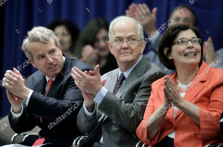 Stock Picture of Michael J. Hogan, Virginia Hogan, Christopher G. Kennedy Incoming University of Illinois president Michael J. Hogan, center, his wife Virginia Hogan, and U of I Board of Trustees Chairman, Christopher G. Kennedy, left, applaud during a news conference, at the University of Illinois at Chicago campus where Hogan was announced the university's 18th president. Hogan will inherit a budget that's short $380 million in overdue state appropriations, money that may not be coming anytime soon. And the former University of Connecticut president will be asked to keep members of Illinois' General Assembly and others with clout away from university admissions. Hogan has his job because of a scandal last year over the influence of politics on admissions, which led to the resignation of then-President B. Joseph White