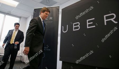Doug Ducey, Greg Stanton Arizona Gov. Doug Ducey, left, and Phoenix Mayor Greg Stanton, right, arrive to attend the opening of the new Uber offices, in Phoenix. The ride-hailing firm opens their new customer service center that is expected to eventually have several hundred employees