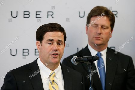 Doug Ducey, Greg Stanton Arizona Gov. Doug Ducey, left, speaks as Phoenix Mayor Greg Stanton listens as they both attend the opening of the new Uber offices, in Phoenix. The ride-hailing firm opens their new customer service center that is expected to eventually have several hundred employees