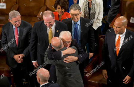 Ashraf Ghani, Robert Menendez, Dan Kildee, Maxine Waters, Al Franken, Cory Booker, Bill Pascrell Afghanistan's President Ashraf Ghani, is embraced by Rep. Bill Pascrell, D-N.J., on Capitol Hill in Washington, after addressing a joint meeting of Congress. From left are, Sen. Robert Menendez, D-N.J., Rep. Dan Kildee, D-Mich., Rep. Maxine Waters, D-Calif., Sen. Al Franken, D-Minn., and Sen. Cory Booker, D-N.J