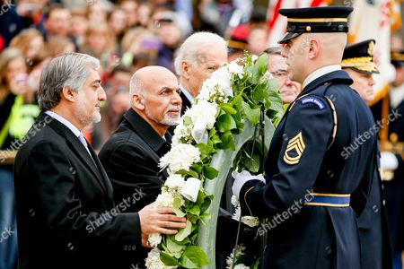 Ashraf Ghani Ahmadzai, Abdullah Abdullah, Joe Bidden, Ash Carter Afghanistan's Chief Executive Officer Abdullah Abdullah, left, and Afghanistan's President Ashraf Ghani, second from left, participate in a wreath laying ceremony at the Tomb of the Unknowns, at at Arlington National Cemetery in Arlington, Va