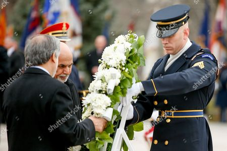 Ashraf Ghani Ahmadzai, Abdullah Abdullah Afghanistan's President Ashraf Ghani, second from left, and Afghanistan's Chief Executive Officer Abdullah Abdullah, left, lay a wreath at the Tomb of the Unknowns, at Arlington National Cemetery in Arlington, Va. Later, President Ghani will meet with President Barack Obama at the White House
