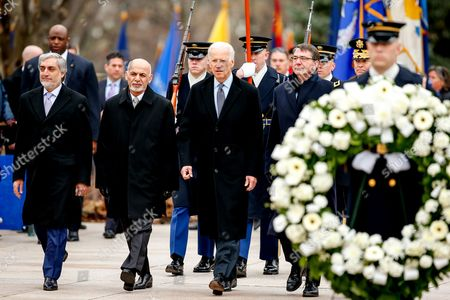 Ashraf Ghani Ahmadzai, Abdullah Abdullah, Joe Bidden, Ash Carter, Jeffery Buchanan From left, Afghanistan's Chief Executive Officer Abdullah Abdullah, Afghanistan's President Ashraf Ghani, Vice President Joe Bidden, Defense Secretary Ash Carter, and Maj. Gen. Jeffrey Buchanan, commanding general, U.S. Army Military District of Washington, arrive for a wreath laying ceremony at the Tomb of the Unknowns, at Arlington National Cemetery in Arlington, Va