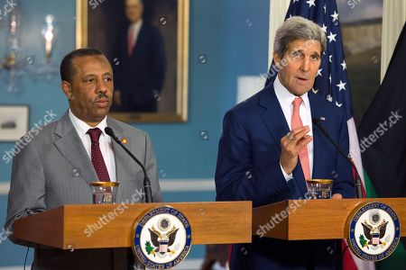 John Kerry, Abdullah al-Thinni Secretary of State John Kerry, right, joined by Prime Minister of Libya Abdullah al-Thinni speaks to media at the State Department, in Washington, during the US Africa Summit. Nearly 50 African heads of state are gathering in Washington for an unprecedented summit