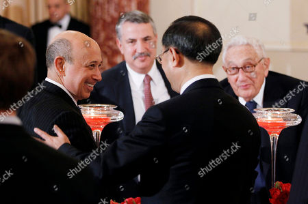Stock Photo of Yang Jiechi, Lloyd Blankfein, Thomas Friedman, Henry Kissinger Goldman Sachs CEO Lloyd Blankfein, left, greets Chinese Foreign Minister Yang Jiechi, second from right, as New York Times columnist Thomas Friedman, second from left, and former Secretary of State Henry Kissinger, right, as they attend a lunch for Chinese Vice President Xi Jinping, hosted by Vice President Joe Biden and Secretary of State Hillary Rodham Clinton, at the State Department in Washington
