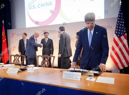 John Kerry, Henry Paulson, Wang Yang, Jack Lew Secretary of State John Kerry, right, looks over his notes as from second from left, former Treasury Secretary Henry Paulson, China's Vice Premier Wang Yang, and Treasury Secretary Jack Lew meet on stage at the 7th US China Strategic and Economic Dialogue (S&ED) and 6th Consultation on People-to-People (CPE) at the US State Department in Washington