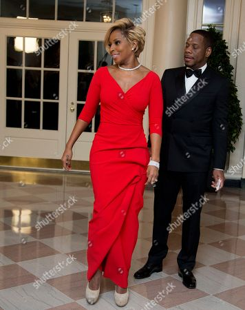 Mary Blige, Kendu Isaacs Singer Mary J. Blige, and Kendu Isaacs, left, arrive for a State Dinner in honor of French President François Hollande, at the White House in Washington