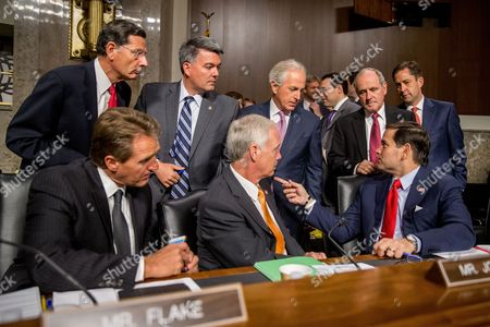 John Barrasso, Cory Gardner, Bob Corker, James Risch, Jeff Flake, Ron Johnson, Marco Rubio Clockwise from top left, Sen. John Barrasso, R-Wyo., Sen. Cory Gardner, R-Colo., Chairman Sen. Bob Corker, R-Tenn., Sen. James Risch, R-Idaho, Sen. Jeff Flake, R-Ariz., Sen. Ron Johnson, R-Wisc., and Republican presidential candidate, Sen. Marco Rubio, R-Fla., speak together before Secretary of State John Kerry, Secretary of Energy Ernest Moniz, and Secretary of Treasury Jack Lew, arrive to testify at a Senate Foreign Relations Committee hearing on Capitol Hill, in Washington, to review the Iran nuclear agreement