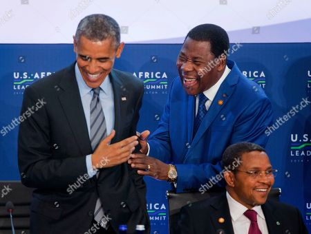 Barack Obama, Yayi Boni, Jakaya Kikwete Benin President Yayi Boni, center, and President Barack Obama, left, smile as Tanzania President Jakaya Kikwete, right takes his seat for the 3rd Session at US African Leaders Summit, at the State Department in Washington. President Barack Obama and dozens of African leaders opened talks Wednesday on two key issues that threaten to disrupt economic progress on the continent: security and government corruption