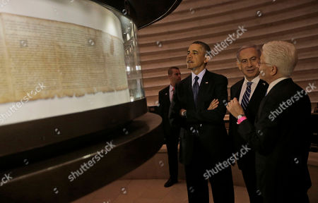 Barack Obama, Benjamin Netanyahu, James Snyder U.S. President Barack Obama, center, and Israeli Prime Minister Benjamin Netanyahu view the Dead Sea Scroll at the Israel Museum in Jerusalem, Israel, . With them is Director of the Museum, James Snyder, far right