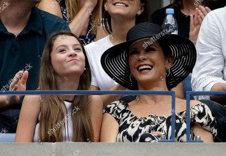 Stock Photo of Catherine Zeta Jones, right, watches from a box with her daughter Carys Zeta Douglas during the women's championship match of the U.S. Open tennis tournament between Roberta Vinci and Flavia Pannetta, both of Italy, in New York
