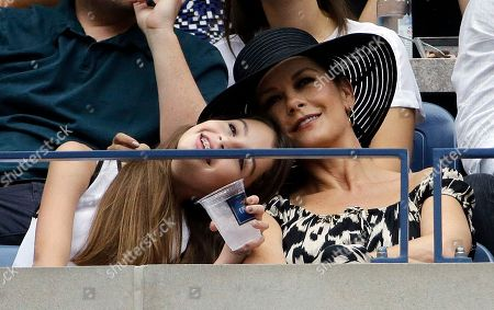 Stock Picture of Catherine Zeta Jones, right, watches from a box with her daughter Carys Zeta Douglas during the women's championship match of the U.S. Open tennis tournament between Roberta Vinci and Flavia Pannetta, both of Italy, in New York