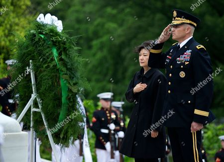 Park Geun-hye, Michael Linnington South Korea President Park Geun-hye, left with Maj. Gen. Michael Linnington, pause as taps is played during a wreath laying ceremony at the Tomb of the Unknowns at Arlington National Cemetery in Arlington, Va