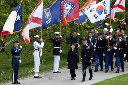 Park Geun-hye, Michael Linnington Visiting South Korea President Park Geun-hye, center left, is escorted by Maj. Gen. Michael Linnington, as they march past the colors of American states, during a wreath laying ceremony at the Tomb of the Unknowns at Arlington National Cemetery in Arlington, Va