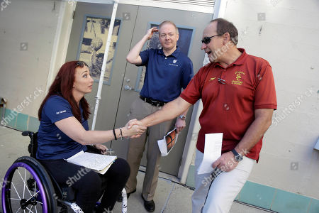 Amy Van Dyken, Dave Salo, Jason Knapp Former Olympic swimmer Amy Van Dyken, left, shakes hands with USC swimming coach Dave Salo, at right, alongside Pac-12 networks announcer Jason Knapp, center, in Berkeley, Calif. The six-time Olympic gold medal swimmer returned to work with the Pac-12 Networks on Friday, nearly eight months after an all-terrain vehicle accident left her paralyzed from the waist down