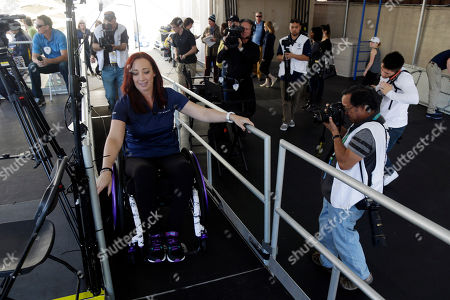 Amy Van Dyken Former Olympic swimmer Amy Van Dyken uses a ramp to access the broadcast booth, in Berkeley, Calif. The six-time Olympic gold medal swimmer returned to work with the Pac-12 Networks on Friday, nearly eight months after an all-terrain vehicle accident left her paralyzed from the waist down