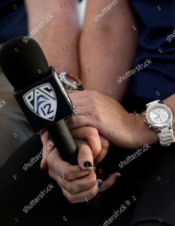 Stock Photo of Amy Van Dyken, Jason Knapp Former Olympic swimmer Amy Van Dyken holds hands with fellow announcer Jason Knapp during her return to broadcasting, in Berkeley, Calif. The six-time Olympic gold medal swimmer returned to work with the Pac-12 Networks on Friday, nearly eight months after an all-terrain vehicle accident left her paralyzed from the waist down