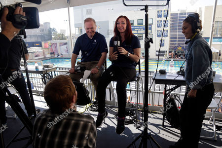 Amy Van Dyken, Jason Knapp Former Olympic swimmer Amy Van Dyken, center right, begins a broadcast with play-by-play announcer Jason Knapp, in Berkeley, Calif. The six-time Olympic gold medal swimmer returned to work with the Pac-12 Networks on Friday, nearly eight months after an all-terrain vehicle accident left her paralyzed from the waist down