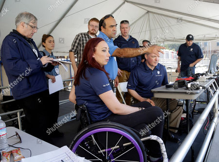 Amy Van Dyken Former Olympic swimmer Amy Van Dyken, center in wheelchair, meets with her production team as she prepares to broadcast a swim meet, in Berkeley, Calif. The six-time Olympic gold medal swimmer returned to work with the Pac-12 Networks on Friday, nearly eight months after an all-terrain vehicle accident left her paralyzed from the waist down