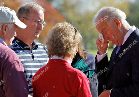 Joe Biden, John Jones, Dr. Leonard Smith, Mary Jane McWilliams, Olga Smith Vice President Joe Biden wipes his eyes as he talks with the family of US Marine Corps David James Smith, from left, step father John Jones, father Dr. Leonard Smith, mother Mary Jane McWilliams, and step mother Olga Smith, at the grave of their son US Marine Corps Sgt. David James Smith, Frederick, Md., in Section 60, on Veterans' Day at Arlington National Cemetery in Arlington, Va