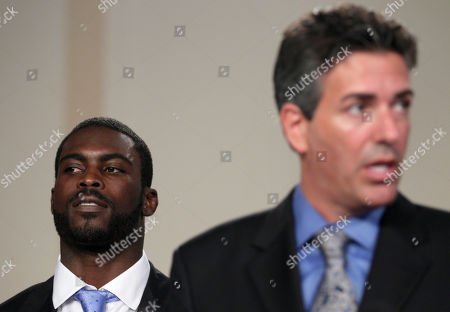 Michael Vick, Wayne Pacelle Philadelphia Eagles football quarterback Michael Vick, listens at left as Wayne Pacelle, president and CEO of the Humane Society of the US, speaks during a news conference on Capitol Hill in Washington, to discuss their support for a bill that will penalize criminals who finance and bring children to dogfights and cockfights