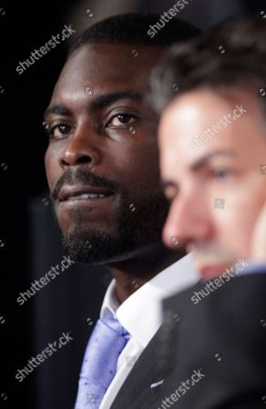 Michael Vick, Wayne Pacelle Philadelphia Eagles football quarterback Michael Vick, (accompanied by Wayne Pacelle, president and CEO of the Humane Society of the US) take part in a news conference on Capitol Hill in Washington, to discuss their support for a bill that will penalize criminals who finance and bring children to dogfights and cockfights
